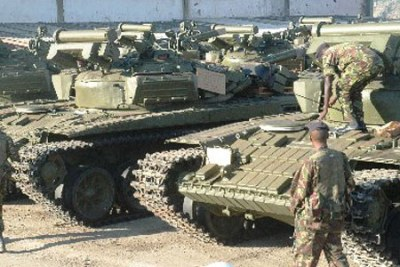 Military officers inspect tanks offloaded in Sudan (file photo).