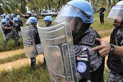 Peacekeepers from the United Nations Operation in Côte d'Ivoire (UNOCI) conduct crowd control exercises near Grand Bassam.