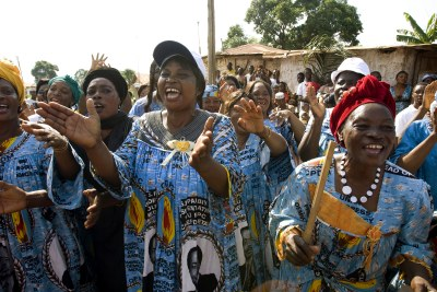 Women in Mbalmayo, Cameroon, clad in dresses with the image of Cameroonian President Paul Biya (file photo),
