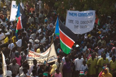 Locals carrying flags and banners celebrating independence (file photo).
