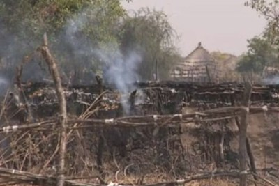 A burning tukul (hut) in Pibor, South Sudan.
