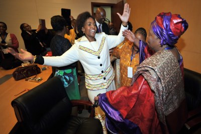South Africa's International Affairs and Co-operation Minister Maite Nkoana-Mashabane congratulates Nkosazana Dlamini-Zuma on her election as the first woman leader of the African Union Commission.