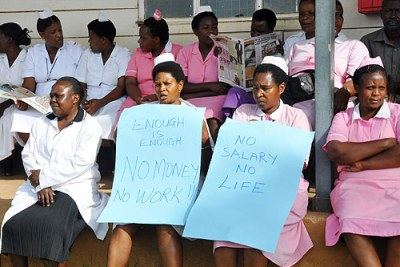 Medics holding placards at Mbarara Hospital.