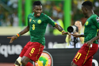Midfielder Ambroise Oyongo celebrates after showing his class with a well-taken goal for Cameroon on Tuesday night.