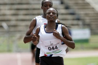 Hellen Obiri (foreground) on her way to winning the 1,500m heat during National Championships at Nyayo Stadium (file photo).