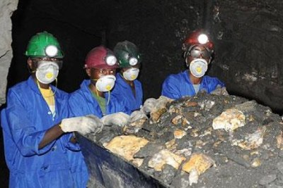 Miners pushing a wagon in a gold mine (file photo).