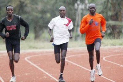Paralympics team's Henry Kirwa (right) with Abraham Tarbei (centre) in action during a past training session.