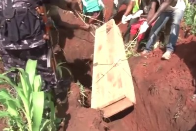 Burial of Kasese clashes victims by Ugandan police.