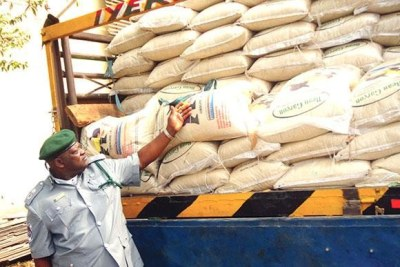 Rice - Customs Area Commander, Oyo/Osun shows smuggled bags of rice intercepted by the command.