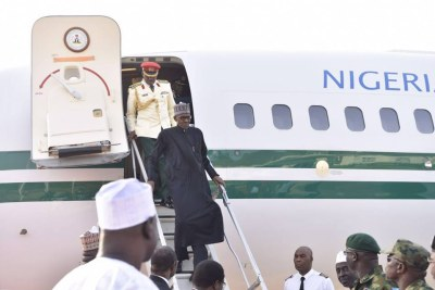 President Buhari arriving from London (file photo).