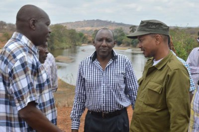 Then-Irrigation Principal Secretary Patrick Nduati (in cap) confers with government officials and residents at the site of the proposed Thwake multi-purpose dam.