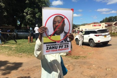 Zanu-PF supporters march against Saviour Kasukuwere.