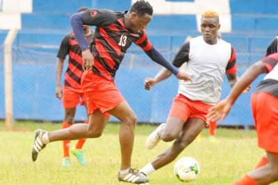 Kenya skipper Victor Wanyama (left) drives forward with the ball under the close attention of David Ochieng during their training session at Machakos's Kenyatta Stadium.