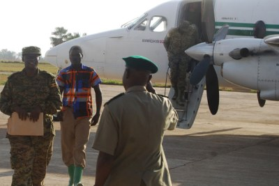 Back. A former LRA member is escorted by UPDF officers after his arrival at Gulu airfield from the Central African Republic early this year. Many ex-rebels who renounced rebellion are yet to received their resettlement packages.