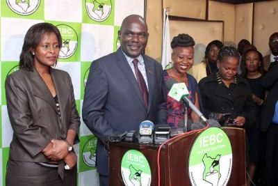 Independent Electoral and Boundaries Commission chairman Wafula Chebukati, vice-chairperson Consolata Maina (left) and Commissioner Roselyn Akombe address journalists.