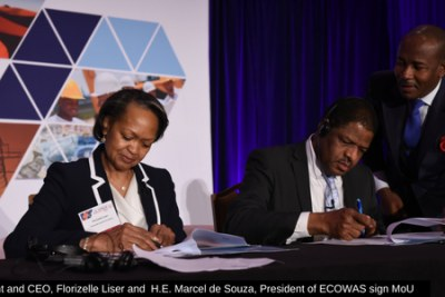 CCA president and CEO, Florizelle Liser and H.E. Marcel de Souza, President of ECOWAS sign a MoU