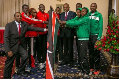 President Uhuru Kenyatta meets members of the teams that will represent Kenya in upcoming athletics events. They met at State House in Nairobi on July 8, 2017.