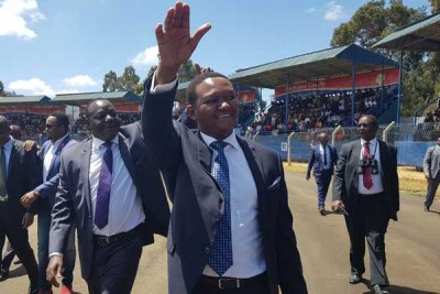 Machakos Governor Alfred Mutua and his new deputy Francis Maliti waving at the crowd before they were sworn in.