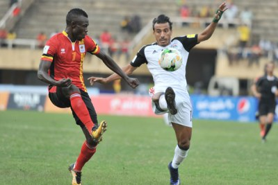 Emmanuel Okwi of Uganda battles against Abouzeid Mohamed of Egypt during the World Cup Qualifiers at Mandela Stadium, Namboole.