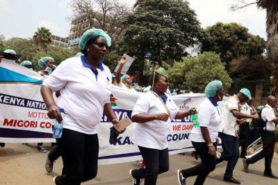 Striking nurses protest outside Afya House in Nairobi.