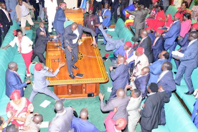 A scene in Parliament after Speaker Rebecca Kadaga suspended 25 MPs including the State Minister for Water Ronald Kibuule.