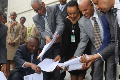 The transition to a paperless system was marked by a paper burning ceremony held at the premises of the Airline.