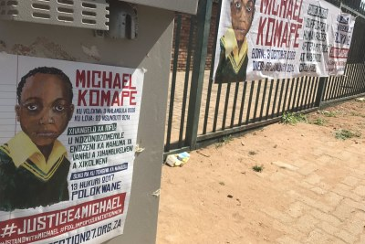 Posters commemorating Michael Komape who died after he fell into a pit toilet at Mahlodumela Primacy School in Chebeng Village, outside Polokwane, on 20 January 2014.