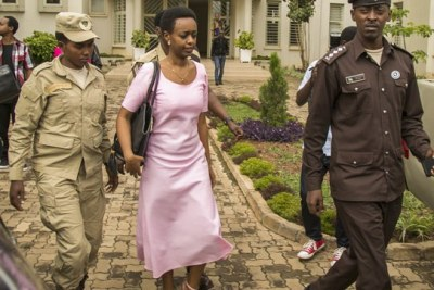 Diane Shima Rwigara escorted out of the Kigali High Court on November 7, 2017 (file photo)