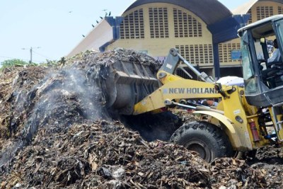 A Mombasa County bulldozer clears a heap of garbage at the Kongowea Market.