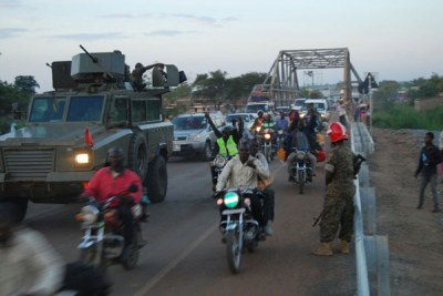 UPDF trucks carrying Ugandans and others from several countries who had been stranded in South Sudan.
