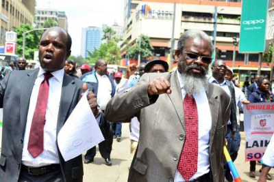 Universities Academic Staff Union Secretary-General Constantine Wasonga (left) and chairman Muga K'Olale demonstrate in Nairobi on November 8, 2017.