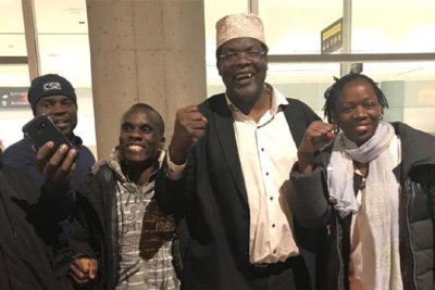 Miguna Miguna (in white hat).