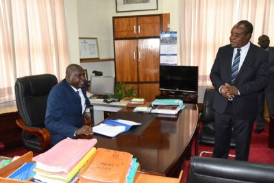 Moi University Vice Chancellor Prof Isaac Kosgey and outgoing acting VC Prof Laban Ayiro during the handing over at the main campus in Uasin Gishu County on March 21, 2018.