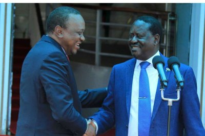 President Uhuru Kenyatta and Nasa leader Raila Odinga conclude a joint press conference about the country's growth, at Harambee House in Nairobi on March 9, 2018.