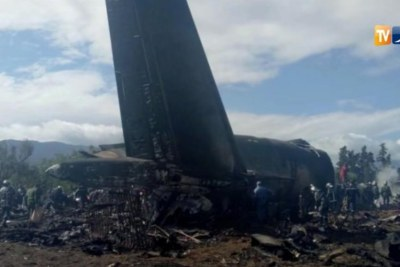 An Algerian military plane is seen after crashing near an airport outside the capital Algiers, Algeria April 11, 2018 in this still image taken from a video.