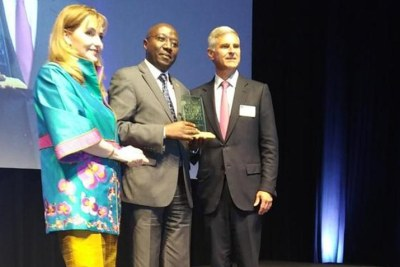 Prime Minister, Edouard Ngirente, middle, accepts the Global Tourism Leadership Award in Buenos Aires, Argentina.