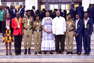 President Yoweri Museveni and First Lady Janet Museveni, who is also the minister of Education and Sports, with Uganda's representatives to the Commonwealth games after a luncheon at State House Entebbe on April 22, 2018.