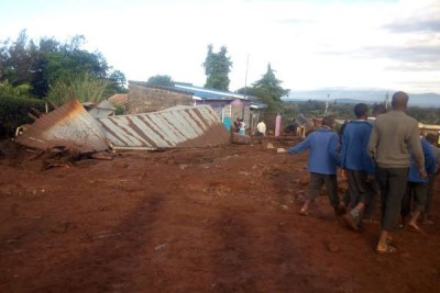 Residents leave after their houses were destroyed by floodwaters from Patel Dam in Solai Ward, Subukia.