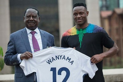 Arsenal die-hard fan Raila Odinga accepting a Tottenham jersey.