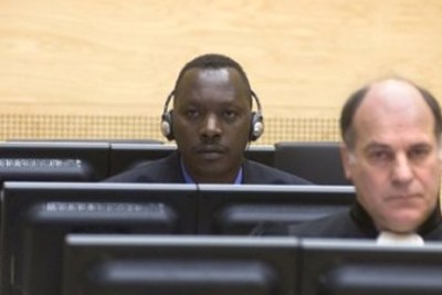 Thomas Lubanga Dyilo and his Duty Counsel, Mr Jean Flamme (Belgium) at the International Criminal Court.