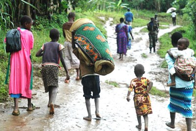 Survivors flee the aftermath of a devastating landslide which displaced 300 000 people of the Mount Elgon region and neighbouring districts.