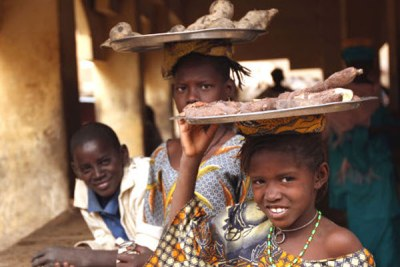 Children selling cassava roots in the market at Dire, a small town on the northern bank of the River Niger, west of Timbuktu, Mali.