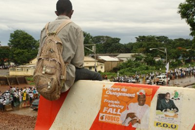 A youth watches a political rally in Conakry ahead of a presidential poll (file photo).
