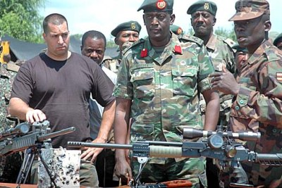 Ugandan officers, headed by Brigadier James Mugira, and a counter-terrorism consultant identified as a Captain Barak inspect the weaponry that will leaders at the African Union summit in Kampala.