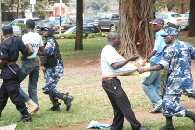 Police arrest demonstrators at Railway Grounds in Kampala on 27 July 2010.