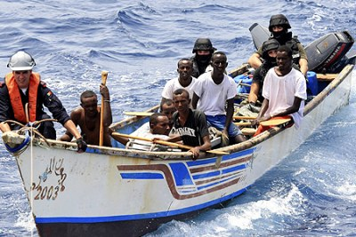 Marines from NATO's Portuguese frigate Corte-Real arrest suspected pirates on their skiff in the Gulf of Aden (file photo).