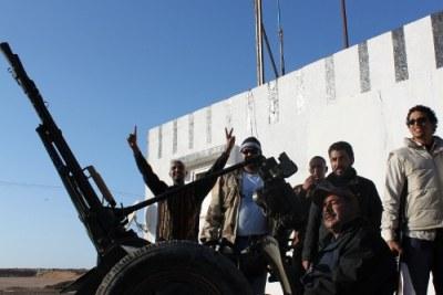 Les forces anti-Gaddafi.