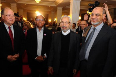 File photo: Newly elected president, Moncef Marzouki, second from left, seen with several opposition leaders in the national assembly.
