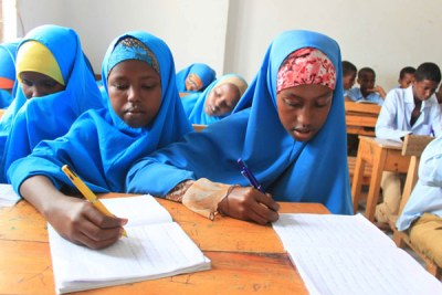 Students writing in class at Alnajah Primary School in Wardhigley district, Somalia (file photo)..