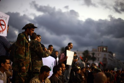 A crowd of demonstrators protest the ongoing use of weapons by rebel militias (file photo).